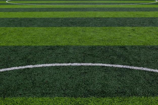 Grünes grasfeld, fußballfeld, fußballfeldhintergrund