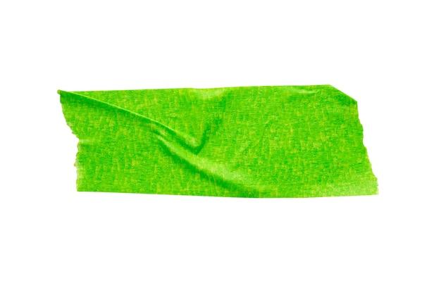 Grünes klebeband isoliert auf weißem hintergrund