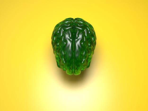 Grünes kristallgehirn auf gelber oberfläche
