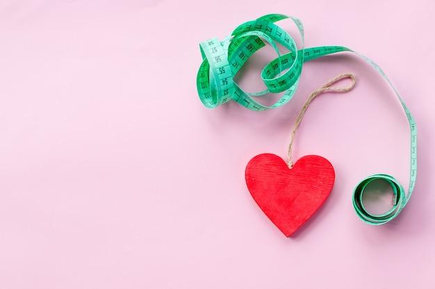 Grünes messendes band, zum einer gesunden diät zu symbolisieren