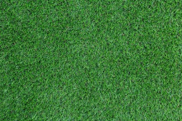 Grünes muster und beschaffenheit des künstlichen grases für hintergrund.