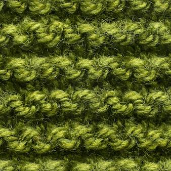 Grünes nahtloses strickmuster für randlose füllung. wiederholtes strickmuster