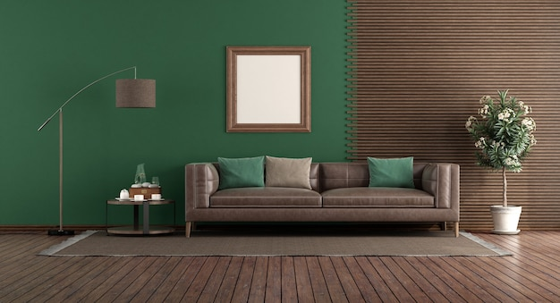 Grünes wohnzimmer mit ledersofa vor einer holztafel
