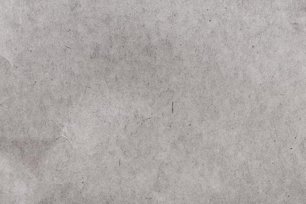 Grundierter strukturierter hintergrund des dunklen kartons grundy