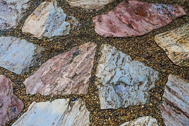 Grundsteinbodenhintergrund der strukturierten oberfläche