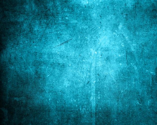 Grunge arthintergrund in den blauen schatten