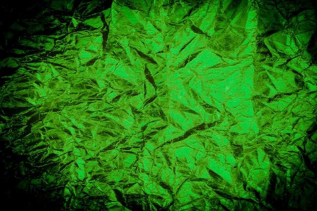 Grunge hellgrüner und vignettenrahmen boder hintergrund