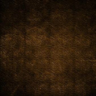 Grunge hintergrund mit einem braunen leder-textur