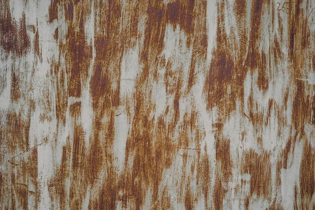 Grunge metallhintergrund mit kratzern und sprüngen bedeckt. rost textur
