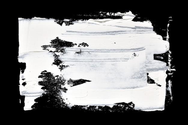 Grunge pinselstriche von ölfarbe auf schwarzem hintergrund
