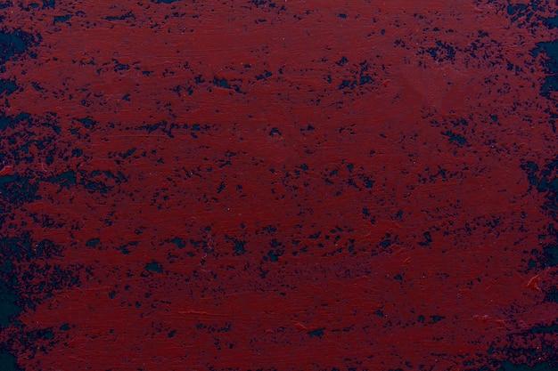 Grunge rote farbwand, abstrakte blaue farbe. entworfener grunge auf wandtextur