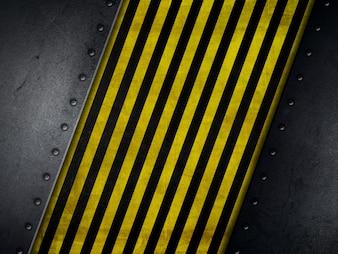 Grunge-Stil Hintergrund mit gelben und schwarzen Warnstreifen