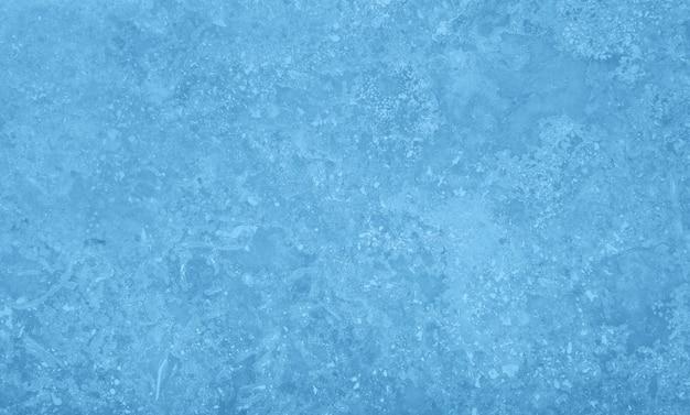 Grunge ungleichmäßiger pastellblauer marmorsteinbeschaffenheitshintergrund mit rissen und flecken