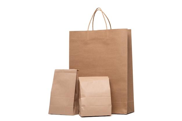 Gruppe des mittagessens papiertüte und einkaufspapiertüten isoliert