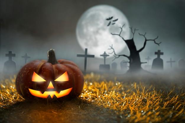Gruseliger halloween-kürbis auf friedhof im mondschein mit totem baum und fledermäusen halloween-party