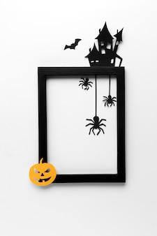 Gruseliger halloween-rahmen mit kürbis