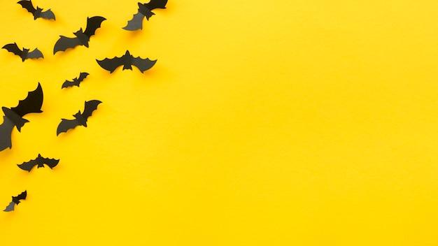 Gruseliges halloween-konzept der draufsicht mit fledermäusen