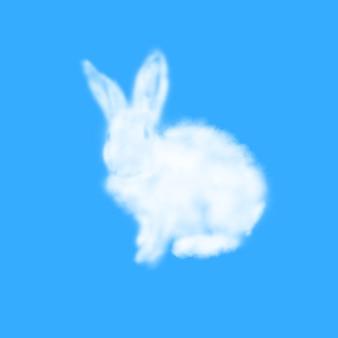 Grußkarte vom flauschigen osterhasen gemacht von der weißen wolke auf einer pastellhimmelblauen oberfläche mit kopienraum. festliche frohe osterkarte.