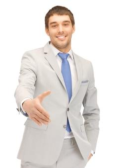 Gut aussehender mann mit offener hand zum händedruck bereit