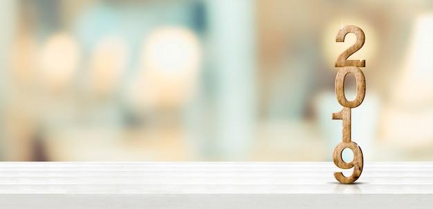 Guten rutsch ins neue jahr 2019 auf tabelle mit blasser weicher bokeh wand