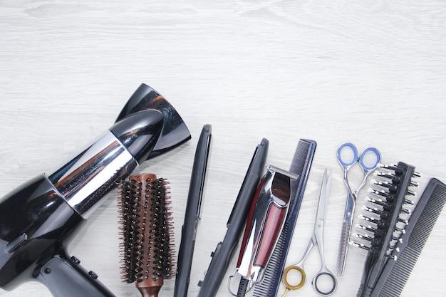 Haarschneidewerkzeuge platz für text kämme scheren und friseurwerkzeuge
