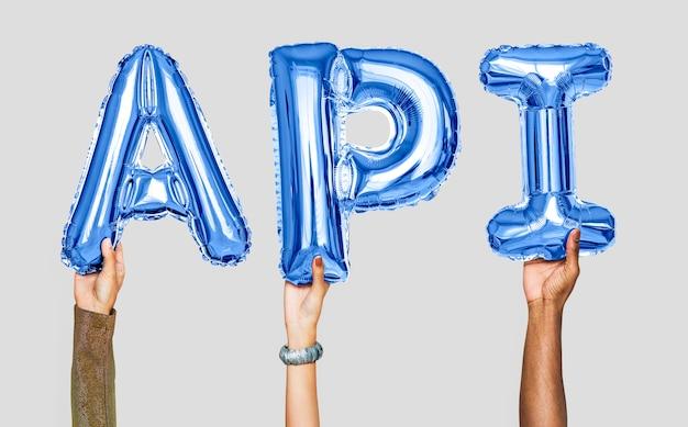 Hände, die api-wort in den ballonbuchstaben halten