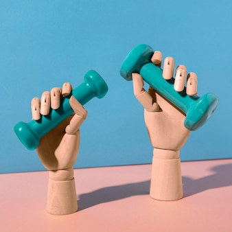Hände halten hanteln stillleben