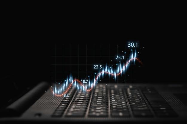 Händler, der laptop-computer mit technischem diagramm und diagramm für analysebörse zum anlagekonzept verwendet.
