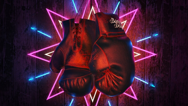 Hängende boxhandschuhe auf hölzerner tabelle.