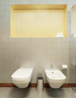 Hängende toilette und bidet an den wandfliesen in grau