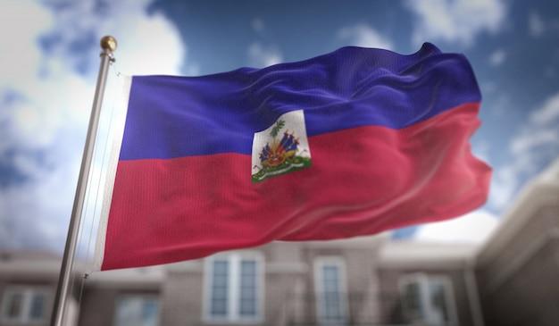 Haiti-flagge 3d-rendering auf blauem himmel gebäude hintergrund