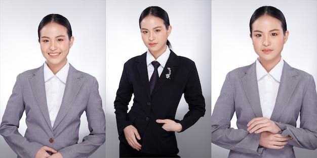 Halbes körperporträt der 20er jahre asiatin schwarzes haar graue anzugjacke. büromädchen wirft viele blicke auf und lächelt über weißem hintergrund isoliert