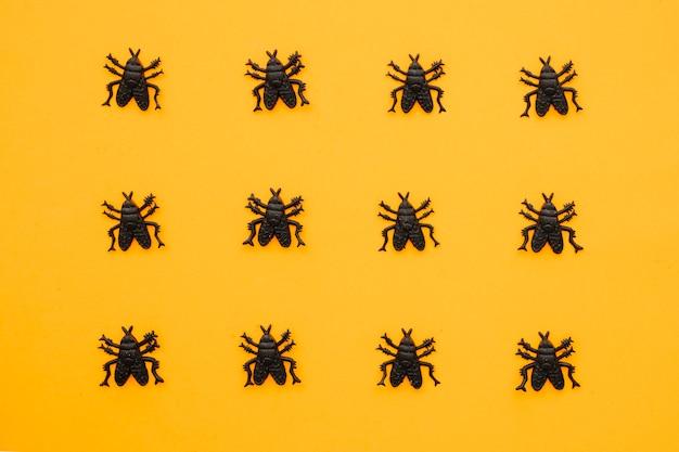 Halloween-komposition mit 12 ameisen