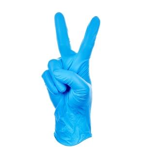 Hand, der das kämpfen mit einem medizinischen handschuhsymbol des blauen nitrils macht.