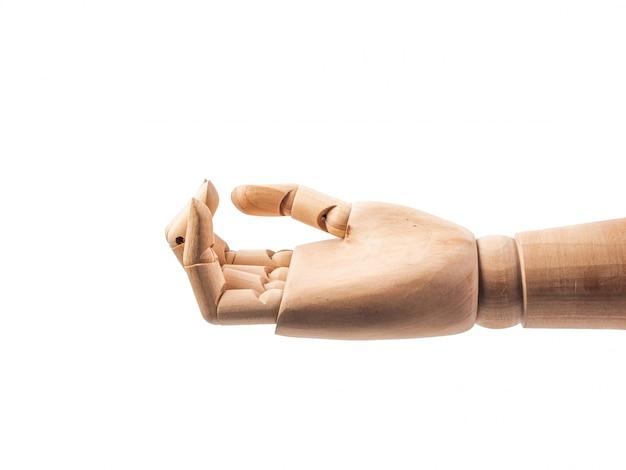Hand der hölzernen puppe lassen finger auf weiß sich berühren