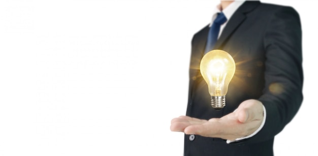 Hand des haltens der belichteten glühlampe, innovationsinspirationskonzept