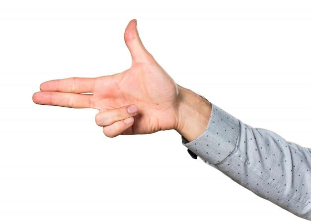 Hand des mannes machen gewehr geste
