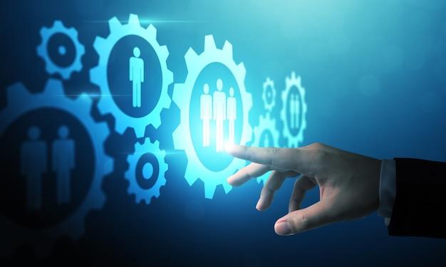 Hand, die auf digitales technologiedesign der humanressourcen zeigt