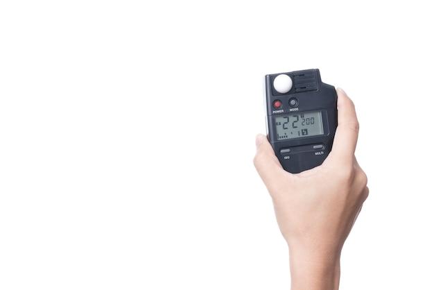 Hand, die belichtungsmesser, ein fotografiegerät für das messen der beleuchtung hält
