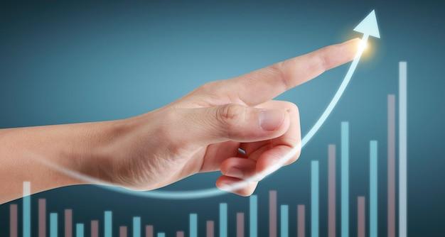 Hand, die ein diagramm des finanzindikators und des diagramms der marktwirtschaftsanalyse der buchhaltung berührt