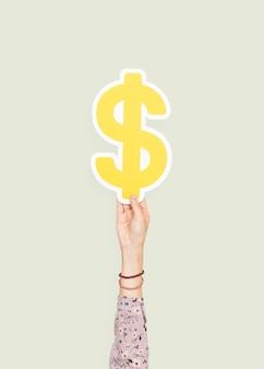 Hand, die ein dollarzeichen anhält