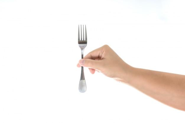 Hand, die eine silberne gabel getrennt auf weiß anhält