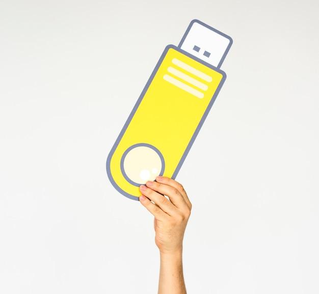 Hand, die flashdisk-speichertechnologie-ikone hält