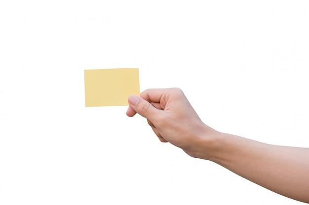 Hand, die gelbes papier hält