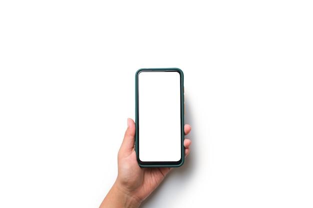 Hand, die handy mit leerem weißem bildschirm hält, lokalisierte weißen hintergrund