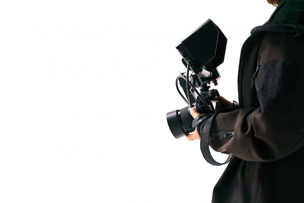 Hand, die kamera mit externem monitor hält