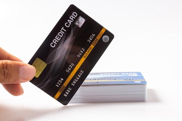Hand, die kreditkarte isoliert hält