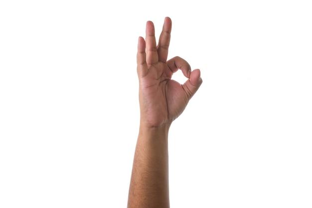 Hand, die okayzeichen gegen weißen hintergrund zeigt. konzept des vertrags- oder genehmigungsgremiums Premium Fotos