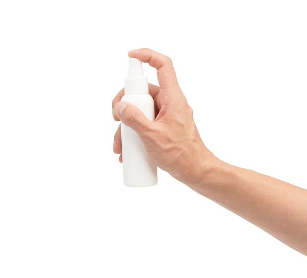 Hand drückt auf alkoholspray