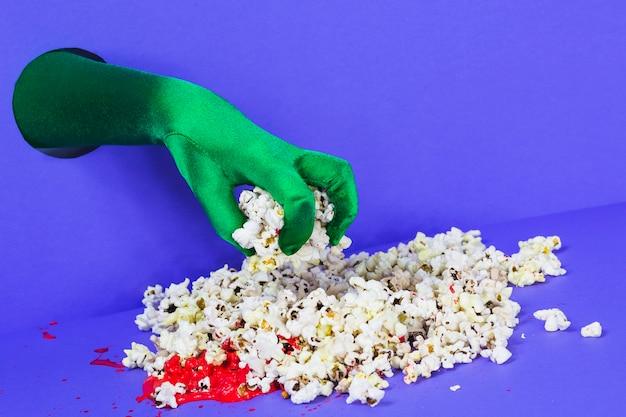 Hand greifen popcorn